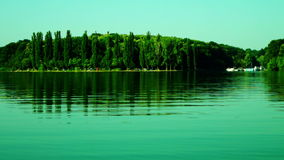 Lacustrine Landscape.Green Forest Reflections On Rippling Lake Waters stock video