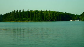 Lacustrine Landscape With Reflections On Rippling Lake Waters And Sound stock footage