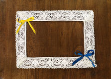 Lacy frame and colorful bows Stock Image