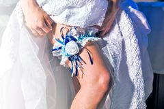 Lacy garter of bride. Lacy garter on the leg of bride Royalty Free Stock Photos