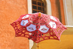 Lacy parasol for women on the counter  street vendors Royalty Free Stock Photo