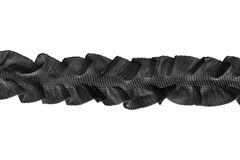 Lacy ribbon. Black lacy ribbon on white background royalty free stock image