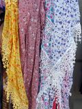 Lacy Scarves. Detail of lacy patterned scarves, or shawls, hanging in shop royalty free stock photos