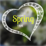 Lacy silhouette of heart with hand drown spring flowers and text Stock Photo