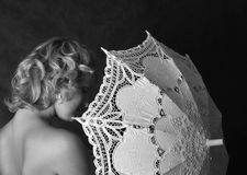 Lacy umbrella. The beautiful woman with a lacy umbrella Royalty Free Stock Images