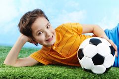 Lad with ball Stock Images