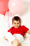 Lad with balloons Stock Image