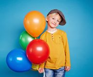 Lad with balloons Stock Photography