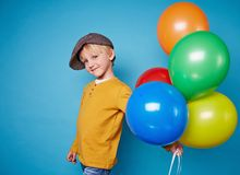 Lad with balloons Stock Photos