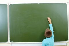 Lad by the blackboard Stock Photo