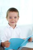 Lad with copybook Royalty Free Stock Photos