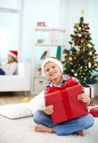 Lad with gift Stock Photos