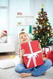 Lad with gift Stock Photography