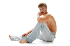 Lad in jeans. Over white Stock Images