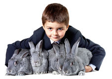 Lad with rabbits Royalty Free Stock Photos