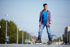 Lad on roller skates Stock Photos