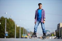 Lad on roller skates Stock Photos