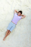 Lad on sand Royalty Free Stock Images