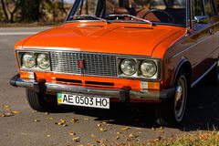 Lada 2106 close-up. Pereshchepino, Ukraine - october 12, 2014: Lada 2106 original orange, released in the USSR in 70's. Car parked on the side of the road. Retro Stock Image