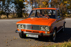 Lada 2106 near the road. PERESHCHEPINO, UKRAINE - OCTOBER 12, 2014: Zhiguli VAZ 2106 original orange, released in the USSR in 70's. Car parked on the side of the Royalty Free Stock Photography