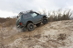 Lada Niva jeep. offroad. Lada Niva jeep on a sandy road. Overcoming a sandy hill royalty free stock photography