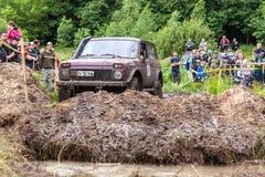 Lada Niva passes a hard pit. Royalty Free Stock Photography
