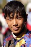 Ladakh festival 2013, ung man med den traditionella klänningen Royaltyfri Bild