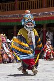Tibetan lamas dressed in mystical mask dance Tsam mystery in time of buddhist festival at Hemis Gompa, Ladakh, North India Royalty Free Stock Images
