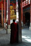 Ladakh - Inside the temple with tourist and monk Royalty Free Stock Image