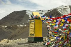 High-mountain pass and Buddhist flags with mantras. Ladakh, Jammu and Kashmir/India - 26.07.2018. High-mountain pass and Buddhist flags with mantras stock photography