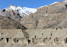 Ladakh landscape. Snow-clad mountains in ladakh india. some natural sand sculptures can also be seen at the bottom Stock Photography
