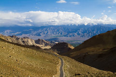 Ladakh path. A narrow road in the midst of the Ladakh Range of mountains Royalty Free Stock Image