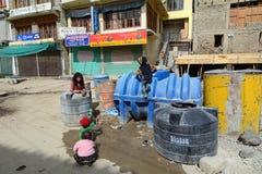 Ladakhi children playing on the mainstreet in Leh Stock Image