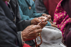 Ladakhi holding wooden rosary beads royalty free stock images
