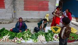 Ladakhi ladies selling fruit and vegetables Stock Photos