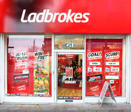 Ladbrokes gambling betting bookies. UK based gaming gambling company, Ladbrokes can be found on most high streets.  Betting offices today are growing in strength Royalty Free Stock Image
