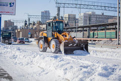 Laddarlokalvårdväg från snö Royaltyfria Bilder