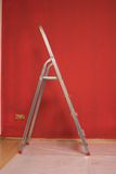 Ladder. A step ladder in a freshly painted red room Stock Images