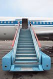 Ladder. Fragment of the plane and ladder in airdrome Royalty Free Stock Image