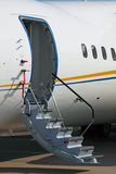 Ladder. Fragment of the plane and ladder in airdrome Royalty Free Stock Photography