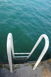 Ladder. An iron ladder to go down into the lake Stock Images