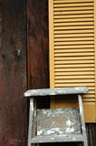 Ladder. A wooden ladder against a window shutter Royalty Free Stock Images