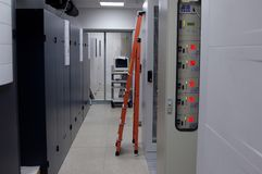 Ladder. In a telecommunication equipment hall Stock Image