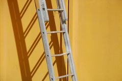 Ladder Against Yellow Wall 3 Royalty Free Stock Photography
