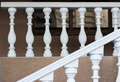 Ladder with balustrade. Stairs to the street with white balustrade Stock Photo