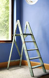 Ladder and blue wall Stock Photography