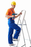 On a ladder Stock Image