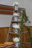 Ladder with cups that spell LOVE for wedding country decoratioon Stock Photo