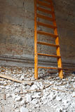 Ladder and debris. Demolition debris in a living room interior construction and ladder royalty free stock photo