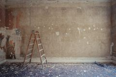 Ladder in empty room during renovation - home decoration, restoration concept.  royalty free stock image